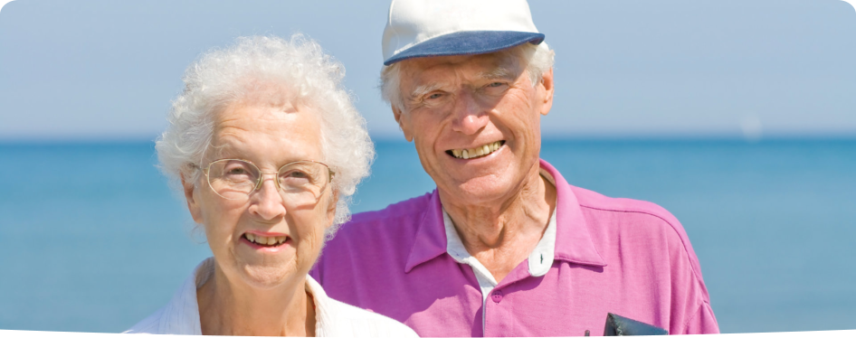 an old couple smiling in the sea