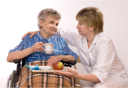 nurse assisting an old woman to her meal