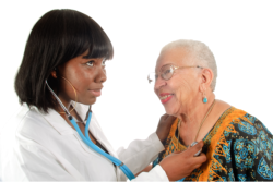 a nurse checking old woman's heartbeat